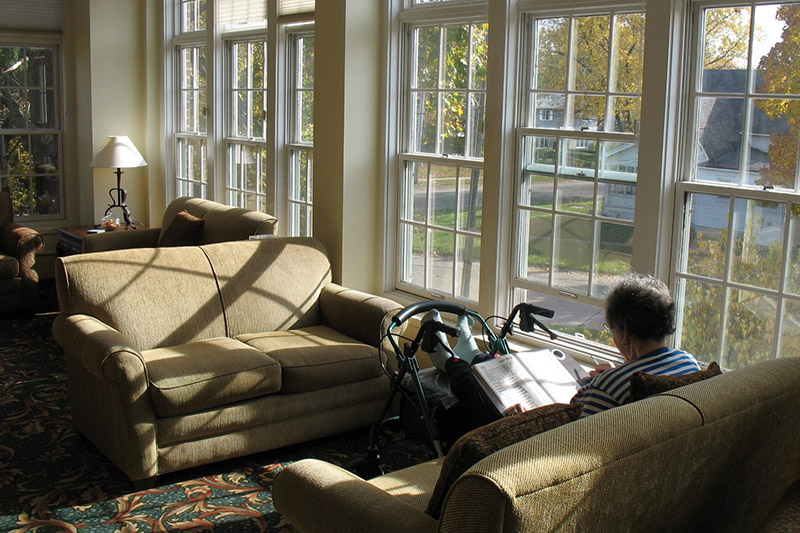 resident reading in sunroom