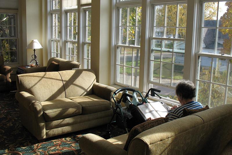 resident reading in sunroom